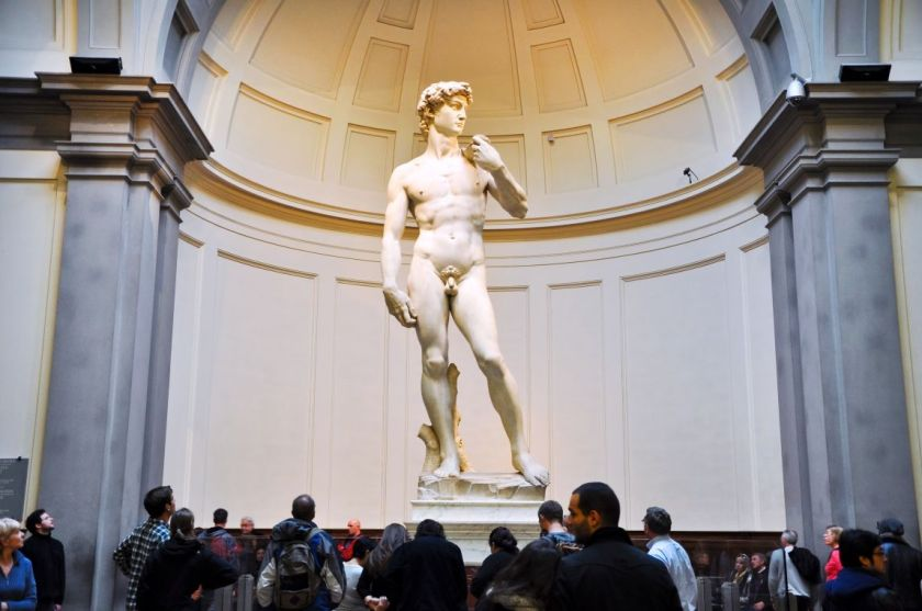 Tourists look at David by Michelangelo on November 10,2010 in Galleria dell'Accademia in Florence. Italy.